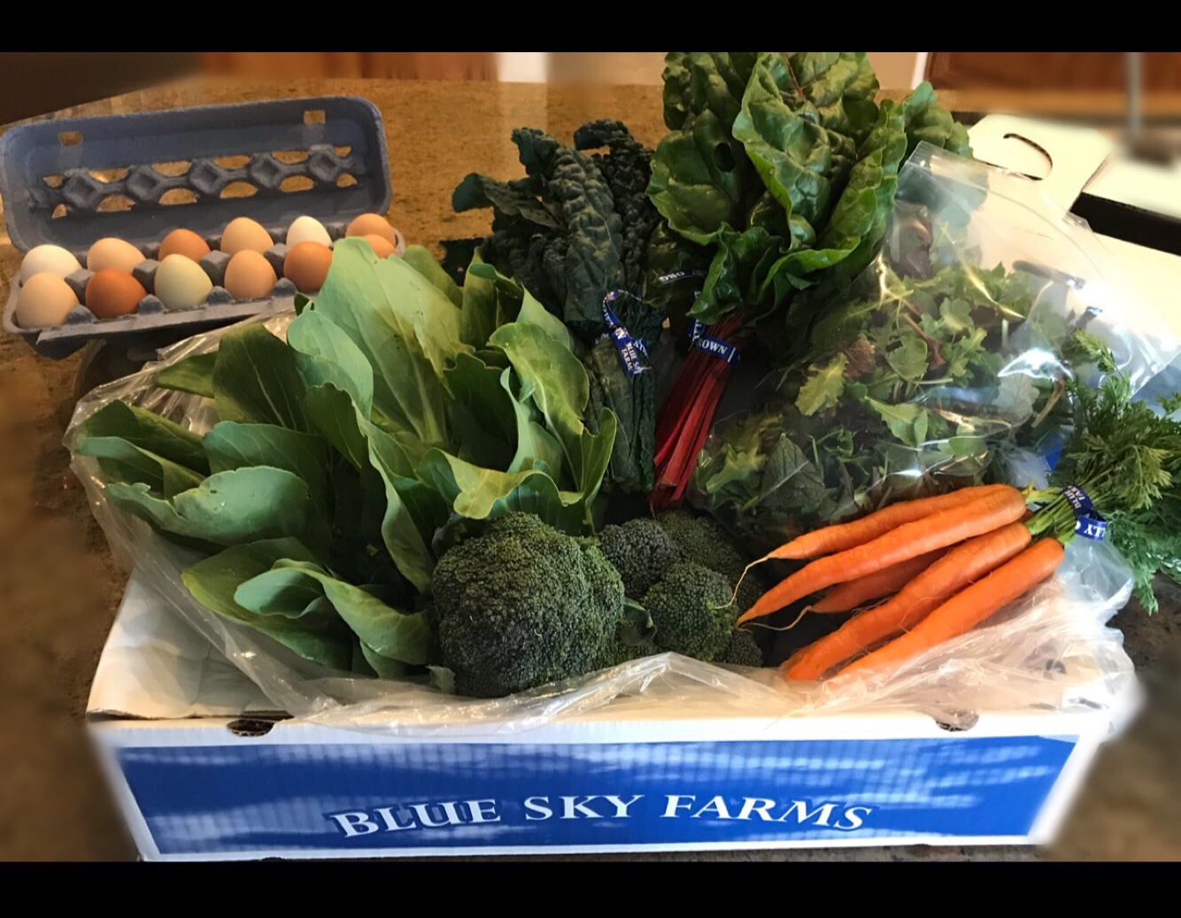 http://blueskyorganicfarms.com/wp-content/uploads/2018/09/CSA-Box_At-Home.jpg
